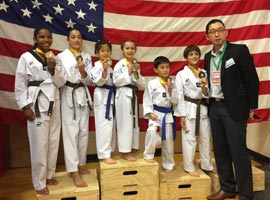children-performing-taekwondo-18256646